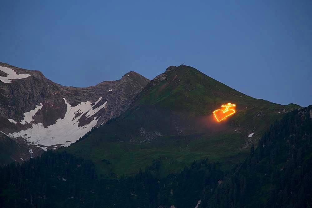 Midsummer Fire on alpine meadow under summit, near Mayrhofen, Zillertal, Tyrol, Austria, Europe