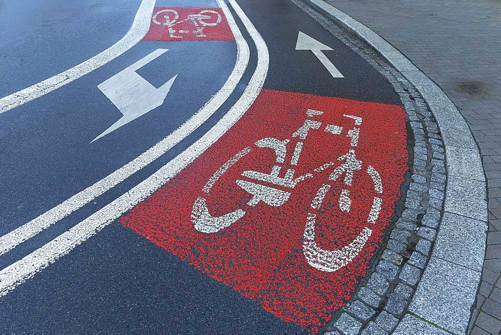 Red marked bicycle paths on the roadway, Krakow, Poland, Europe