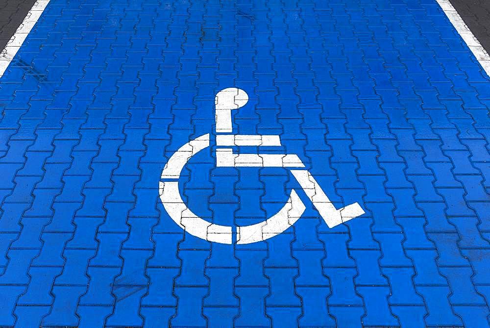 Blue marked parking for disabled, Krakow, Poland, Europe