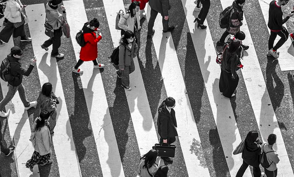 Single person in red, Shibuya crossing, crowds at intersection, many people cross zebra crossing, black and white, Shibuya, Udagawacho, Tokyo, Japan, Asia