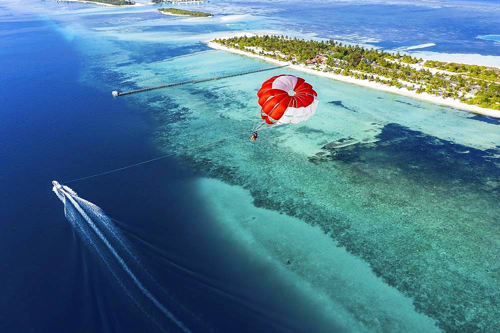 Drone shot, Paraglider flies over Atoll, South-Male-Atoll, Maldives, Asia - 832-385600