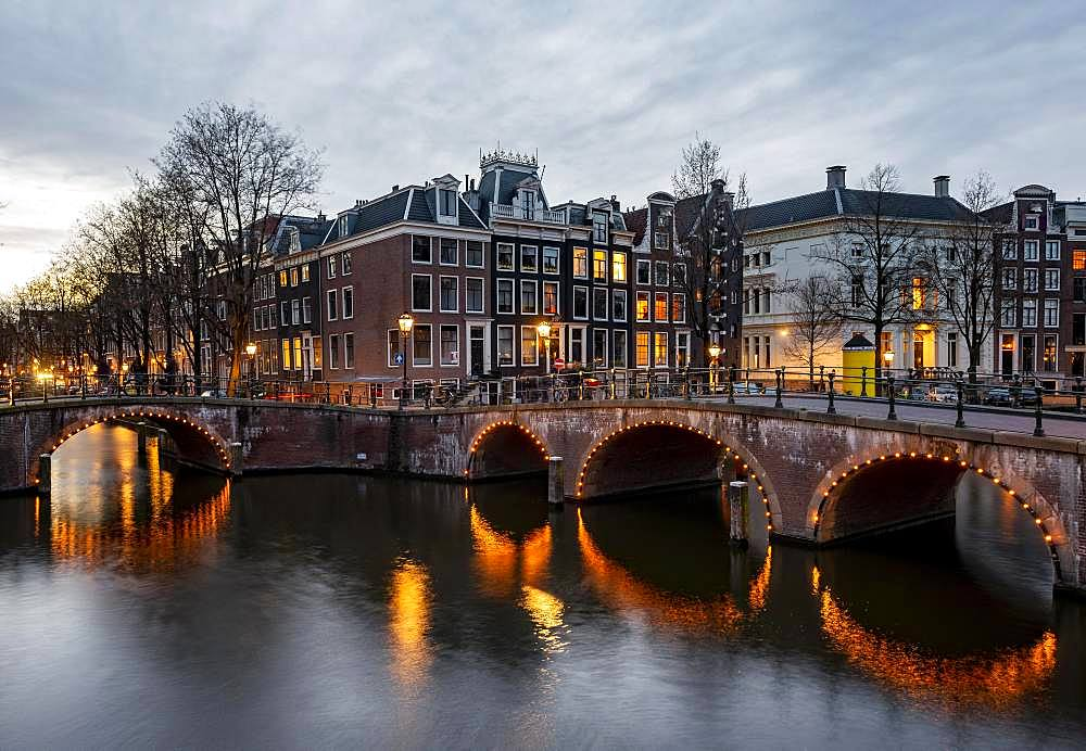 Canal with bridge at dusk, Keizersgracht and Leidsegracht, Amsterdam, North Holland, Netherlands