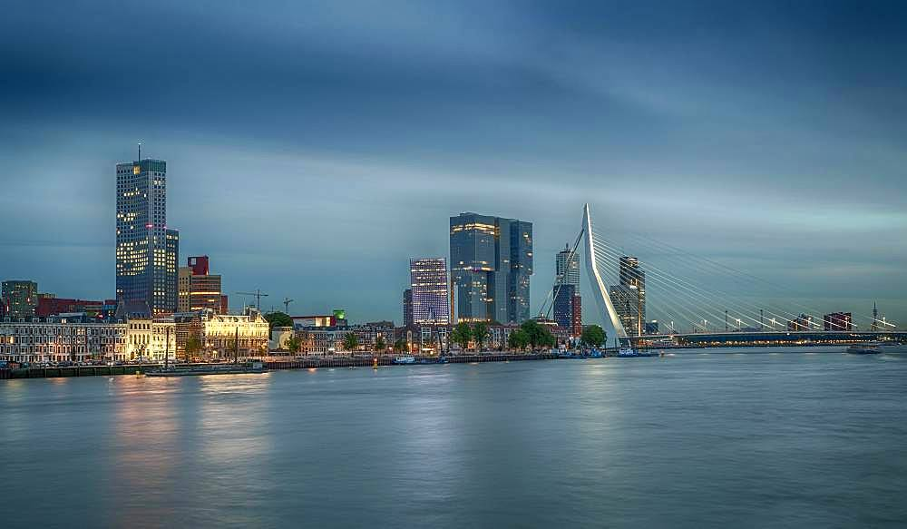 Erasmus bridge in front of skyline, dusk, Rotterdam, Netherlands