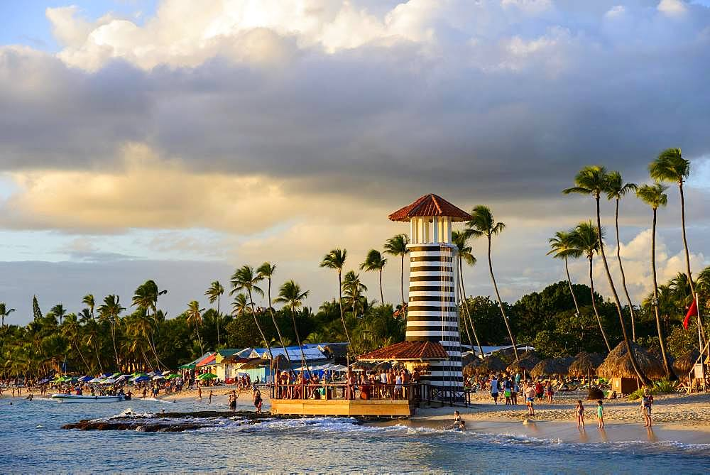 Lighthouse in the evening light, bar of Hotel Iberostar Hacienda Dominicus, beach Dominicus, Bayahibe, Dominican Republic, Central America