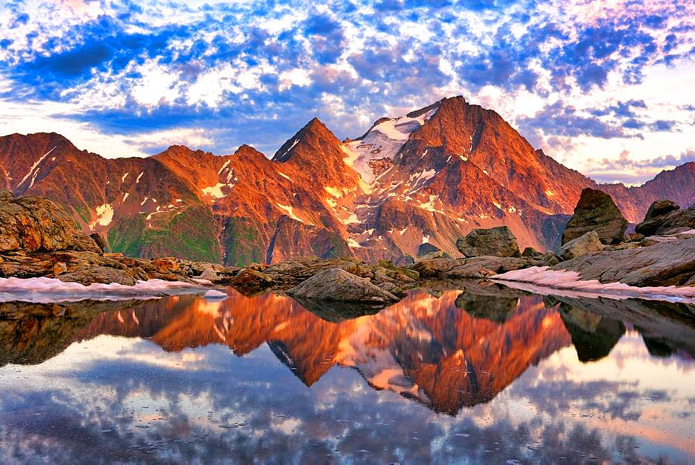 Reflection of the Oberalpstock in a mountain lake, Maderanertal, Canton Uri, Switzerland, Europe