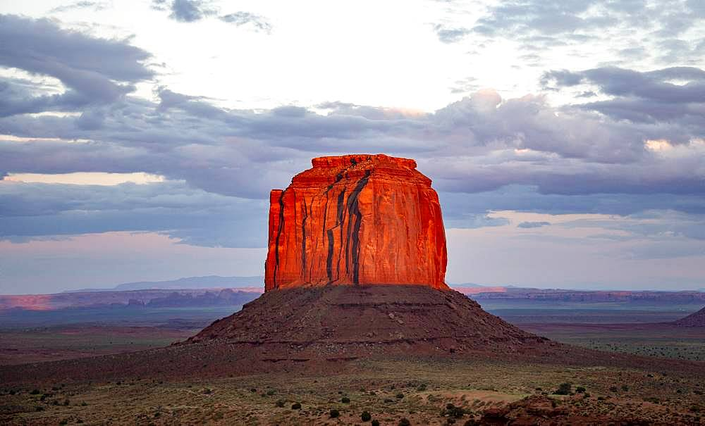 Table Mountain glows red at sunset, Merrick Butte, Navajo Tribal Park, Navajo Nation Reservation, Arizona, Utah, USA, North America
