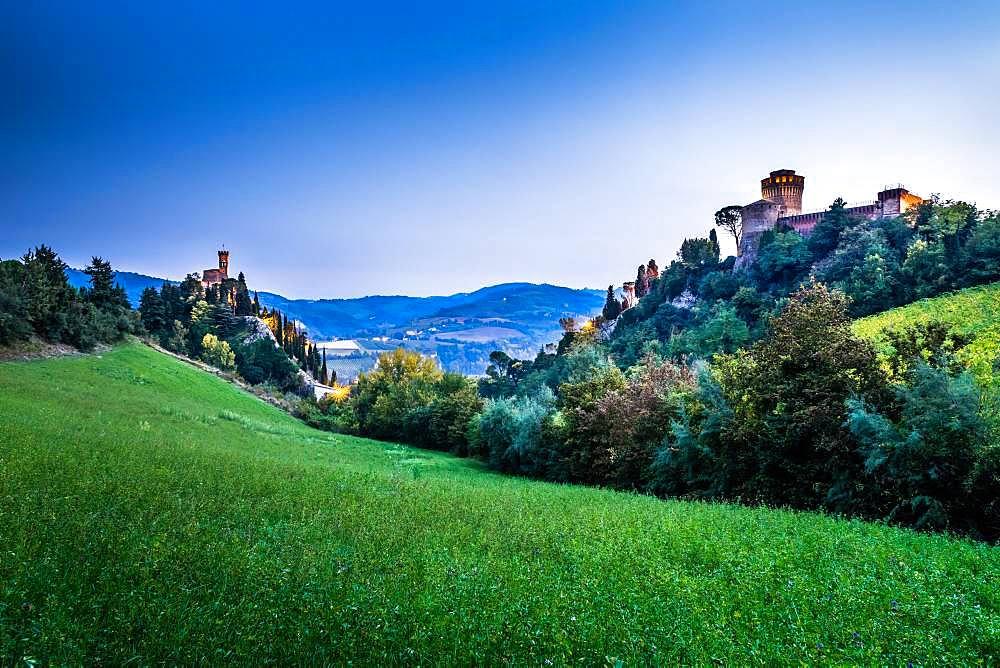 Clock tower Torre dell'Orologio and fortress Rocca Manfrediana at dusk, Brisighella, Emilia-Romagna, Italy, Europe