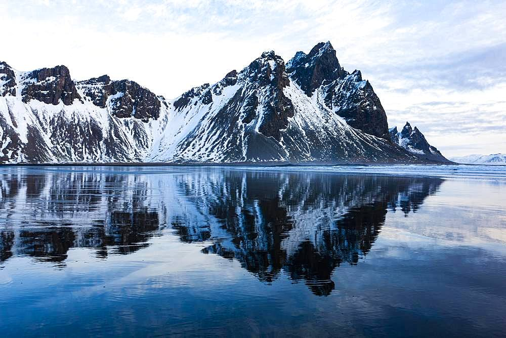 Mountain Vestrahorn with water reflection in the bay of Hornsvik, Austurland, South Iceland, Iceland, Europe
