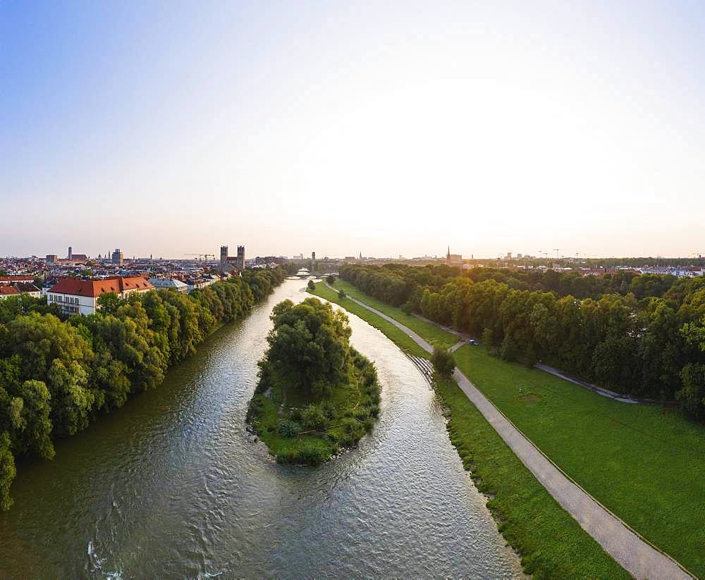 Willow island in Isar and green areas at sunrise, Maximilianskirche and Deutsches Museum at the back, aerial view, Munich, Upper Bavaria, Bavaria, Germany, Europe