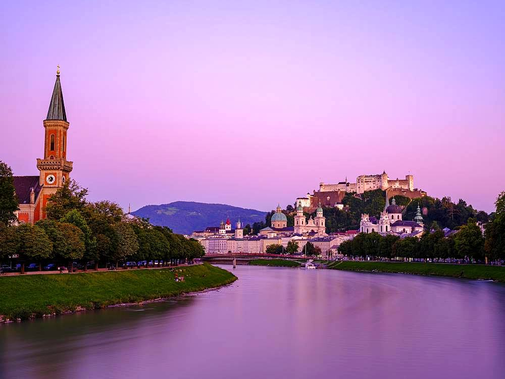 City view, old town and fortress Hohensalzburg over the river Salzach at dusk, Salzburg, Land Salzburg, Austria, Europe
