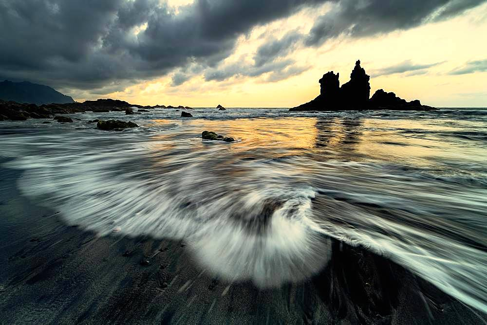 Dramatic cloud atmosphere with rock formation at sunset on the beach of Playa de Benijo, Canary Island, Tenerife, Spain, Europe