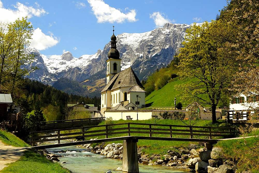 Parish church St. Sebastian in spring with Ramsauer Ache, Reiteralpe at the back, Ramsau, Berchtesgaden, Berchtesgadener Land, Upper Bavaria, Bavaria, Germany, Europe