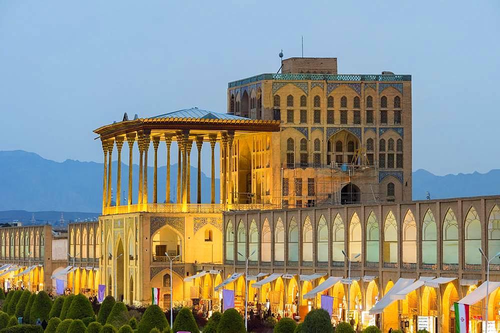 Illuminated Ali Qapu palace at dusk, Maydam-e Iman square, Esfahan, Iran, Asia