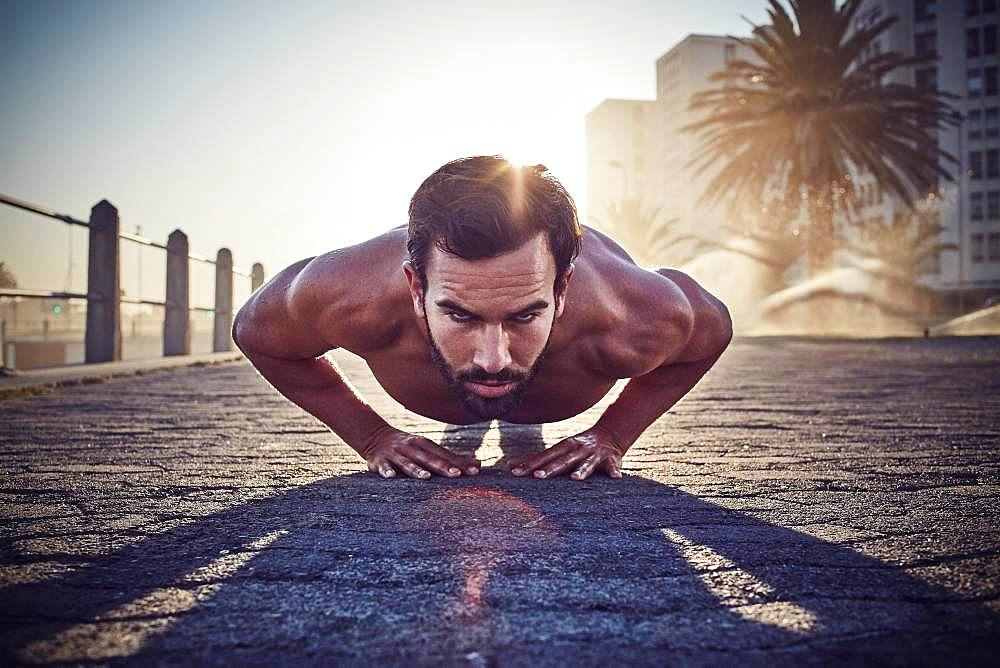 Young man training, doing push-ups, outdoor sports, gymnastics, Cape Town, South Africa, Africa