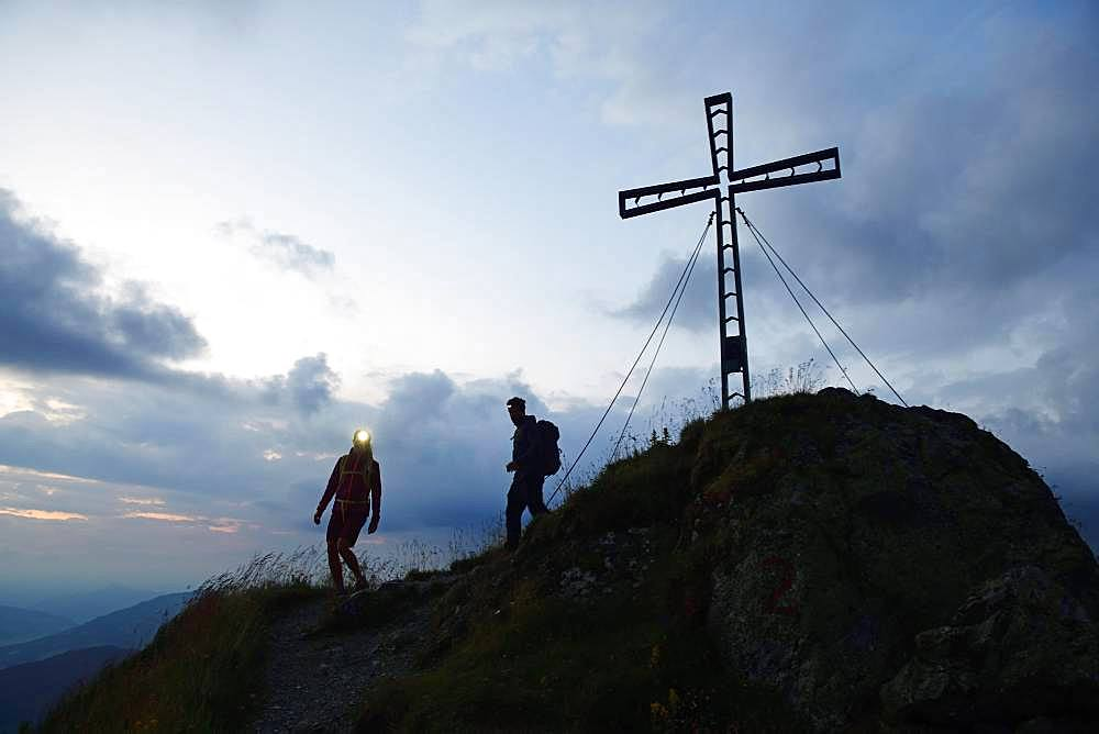 Hikers at dawn on the summit of the Feldalphorn, Kelchsau, Kitzbuehel Alps, Tyrol, Austria, Europe