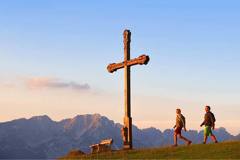 Hikers at the summit cross of the Kraftalm, in the background the Wilder Kaiser Mountains, Hohe Salve, Itter, Kitzbuehel Alps, Tyrol, Austria, Europe