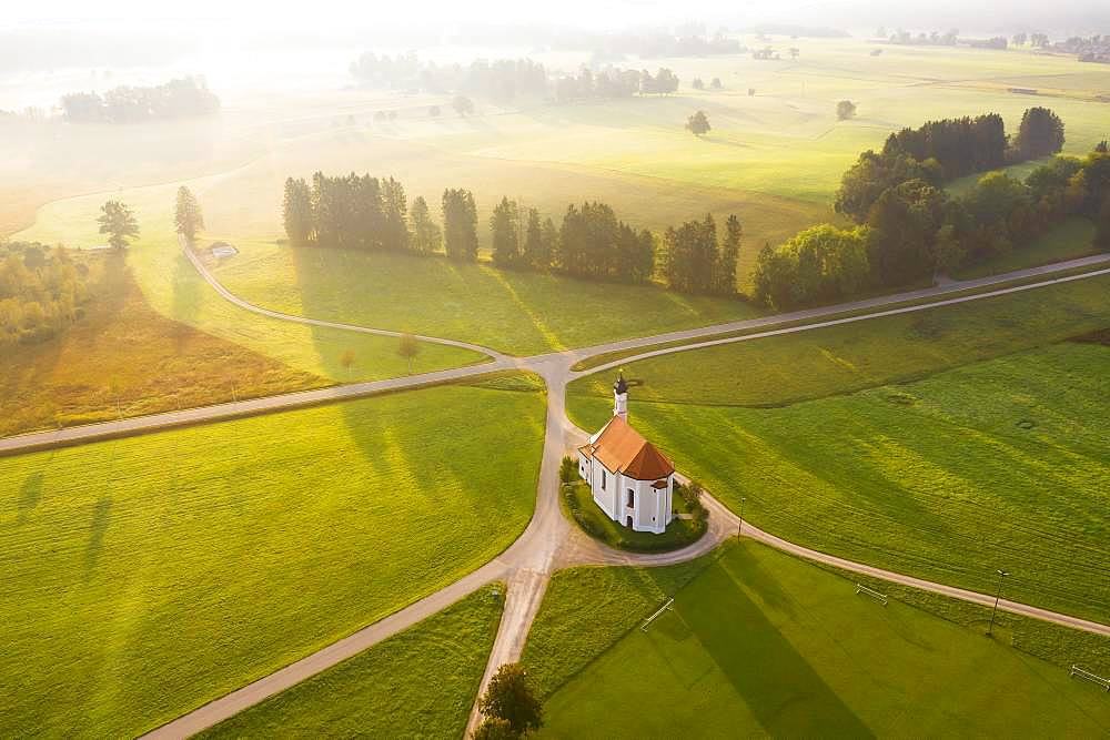Aerial view, Church St. Leonhard, Leonhardikirche, in the morning light, Dietramszell, Toelzer Land, Upper Bavaria, Bavaria, Germany, Europe