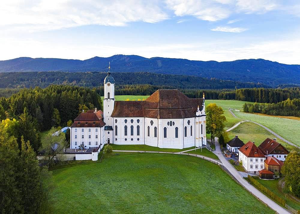 Wieskirche in the morning light, pilgrimage church to the Scourged Saviour on the Wies, Wies, near Steingaden, Pfaffenwinkel, aerial view, Upper Bavaria, Bavaria, Germany, Europe