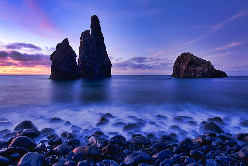Volcanic rock formation Ilheus da Rib, steep coast of Ribeira de Janela, also Ribeira da Janela, blue hour, sunset, Porto Moniz, island Madeira, Portugal, Europe