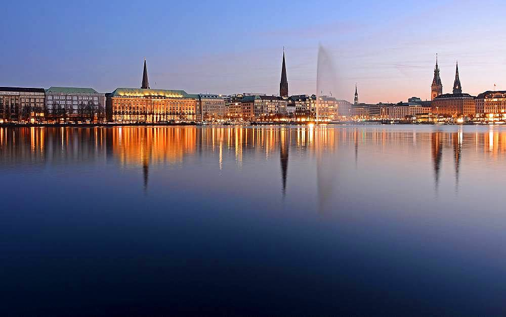 Inner Alster Lake with Alster fountain at dusk, Hamburg, Germany, Europe