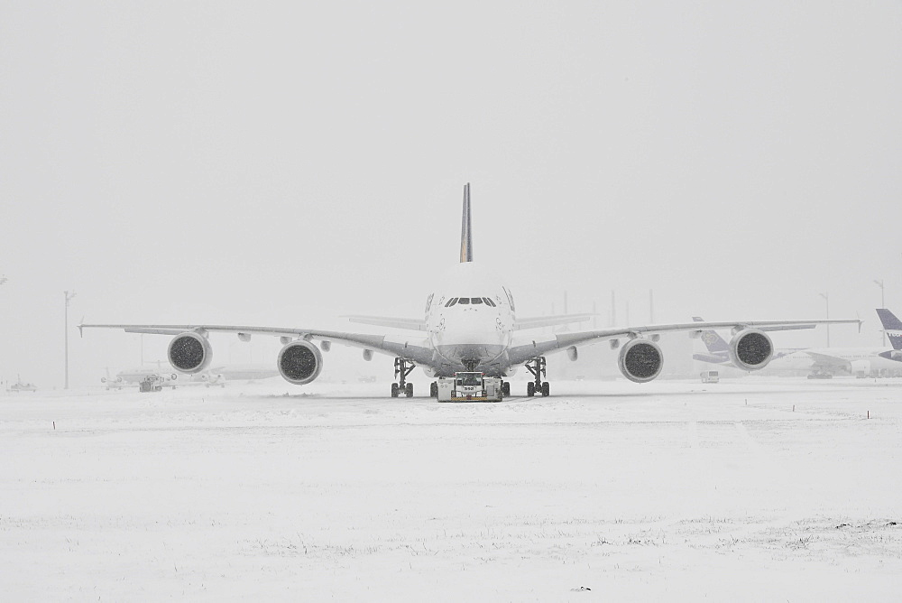 Lufthansa, Airbus, A380-800, during heavy snowfall in winter, Munich Airport, Upper Bavaria, Bavaria, Germany, Europe