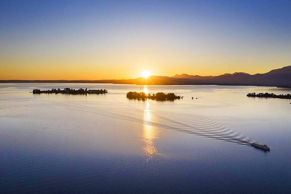 Sunrise, Chiemsee with islands Fraueninsel and Krautinsel, Chiemgau, aerial view, Upper Bavaria, Bavaria, Germany, Europe