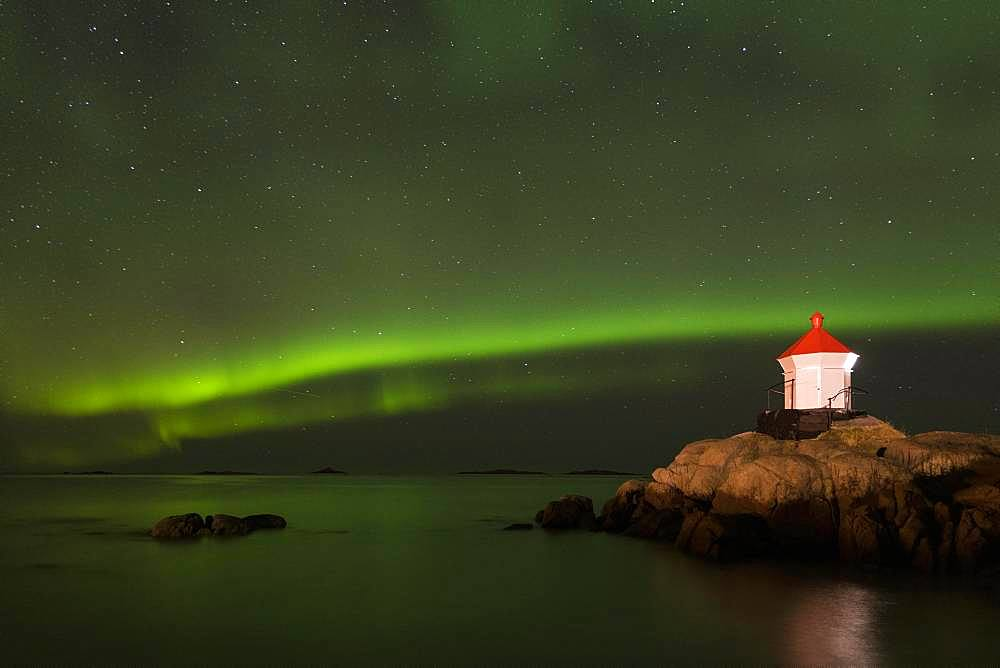 Northern Lights via lighthouse (Aurora borealis), Eggum, Vestvagoy, Lofoten, Norway, Europe