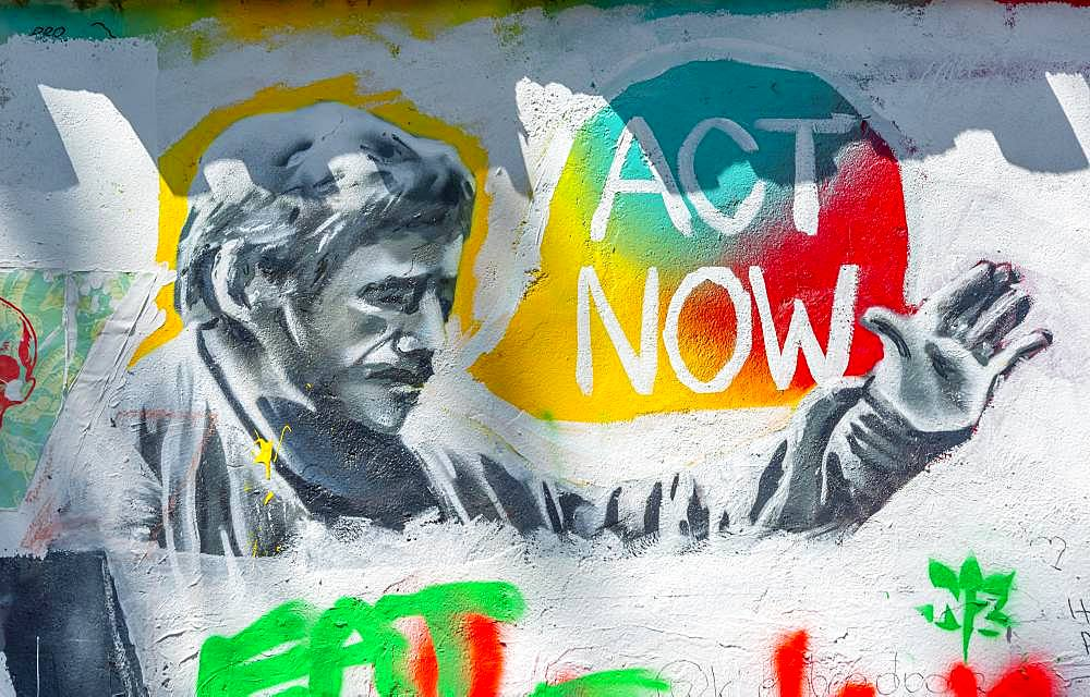 Act Now, colorful graffiti on the John Lennon Wall, Prague, Bohemia, Czech Republic, Europe
