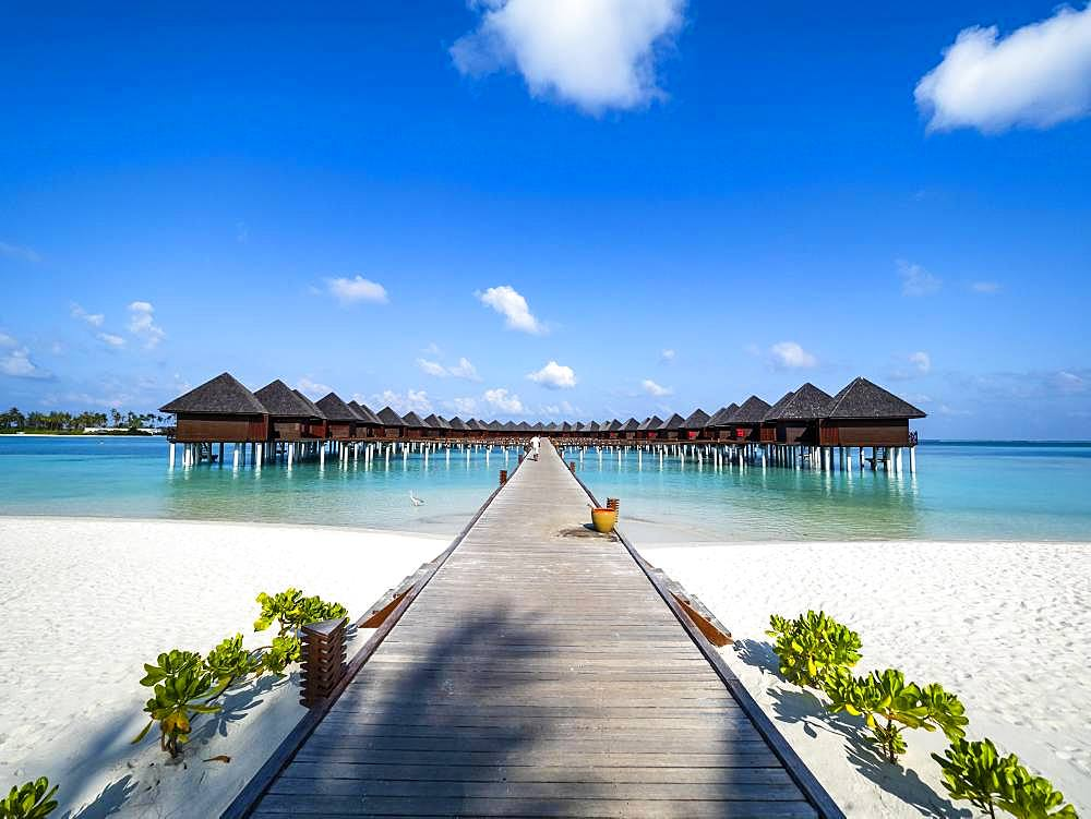 Footbridge over shallow water to water bungalows, island in South Male Atoll, Maldives, Asia