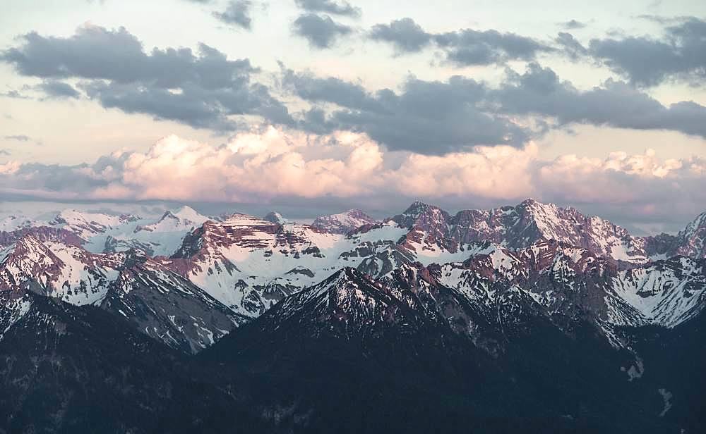 Karwendel Mountains, Grosse Seekarspitze, view of snow-covered mountains at sunset with cloudy sky, Alps, Upper Bavaria, Bavaria, Germany, Europe