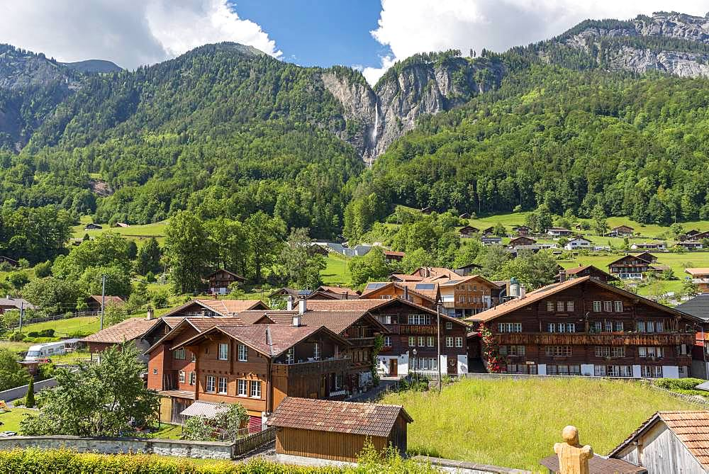Village with wooden houses, behind Muehlebach falls, Brienz, Bernese Oberland, Canton Bern, Switzerland, Europe