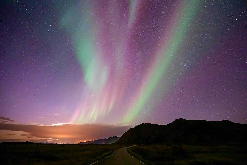 Northern Lights over mountain landscape (Aurora borealis), Lofoten, Norway, Europe
