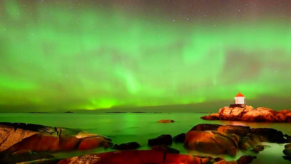 Northern Lights (Aurora borealis) above lighthouse, Eggum, Vestvagoy, Lofoten, Norway, Europe