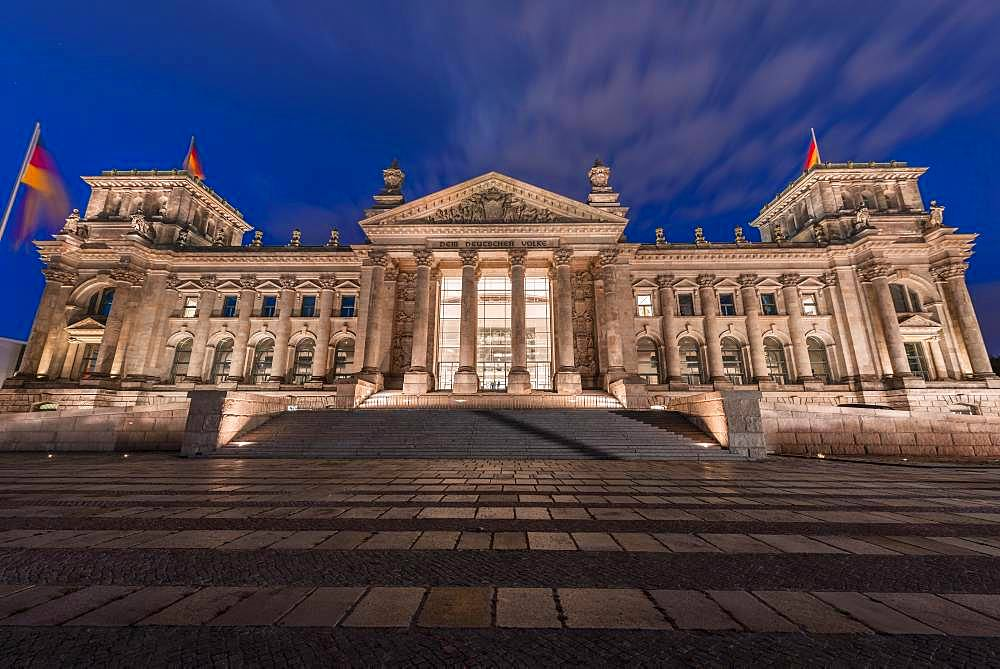 Reichstag with waving German flag, night photograph, government district, Berlin, Germany, Europe