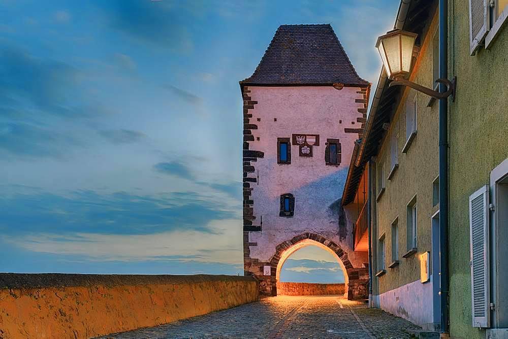 Hagenbachturm illuminated at dusk, Breisach am Rhein, Baden-Wuerttemberg, Germany, Europe