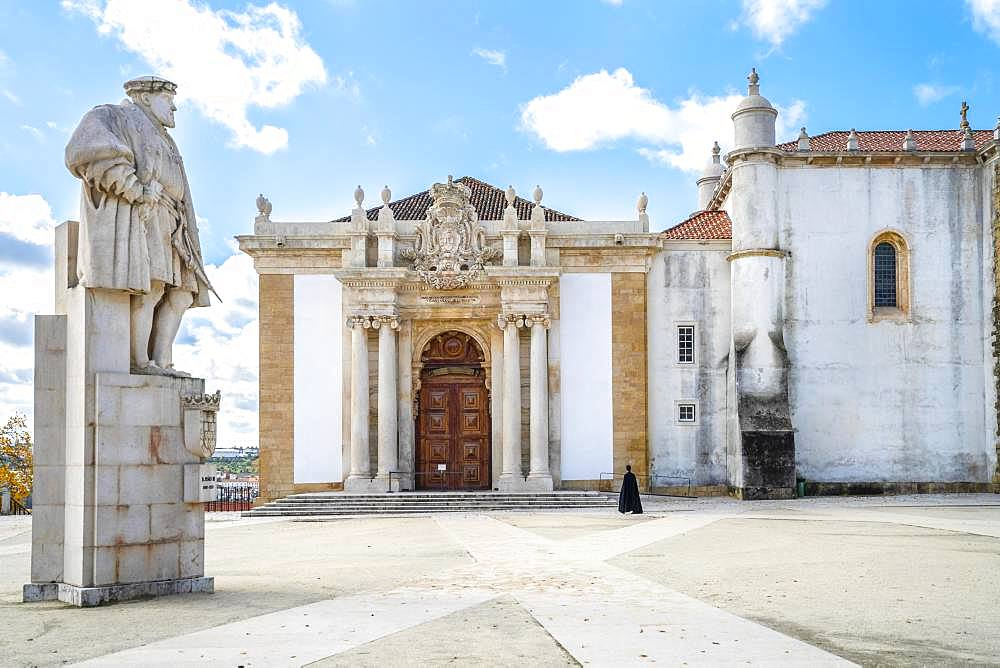 A student in traditional cloth walking through University of Coimbra, one of the oldest universities in Europe, Coimbra, Portugal, Europe