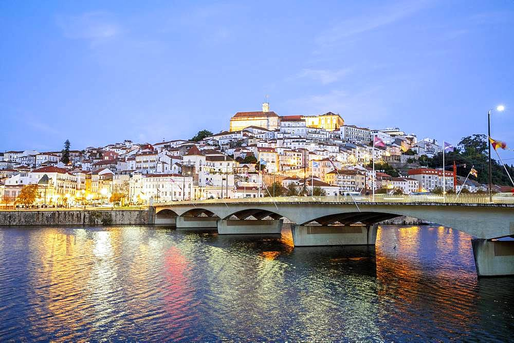 Cityscape with university at top of the hill in the evening, Coimbra, Portugal, Europe