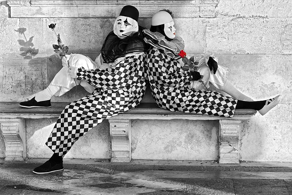 Pierrot, sitting on stone bench, rose coloured, Venice, Italy, Europe