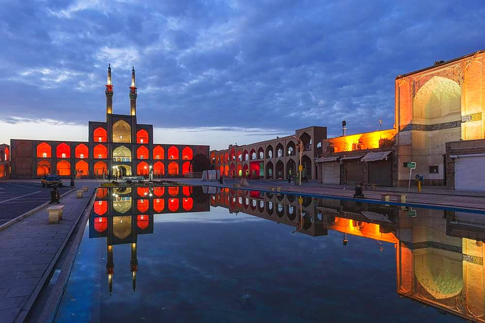Amir Chaqmaq complex facade illuminated at sunrise and reflecting in a pond, Yzad, Yazd province, Iran, Asia - 832-386944