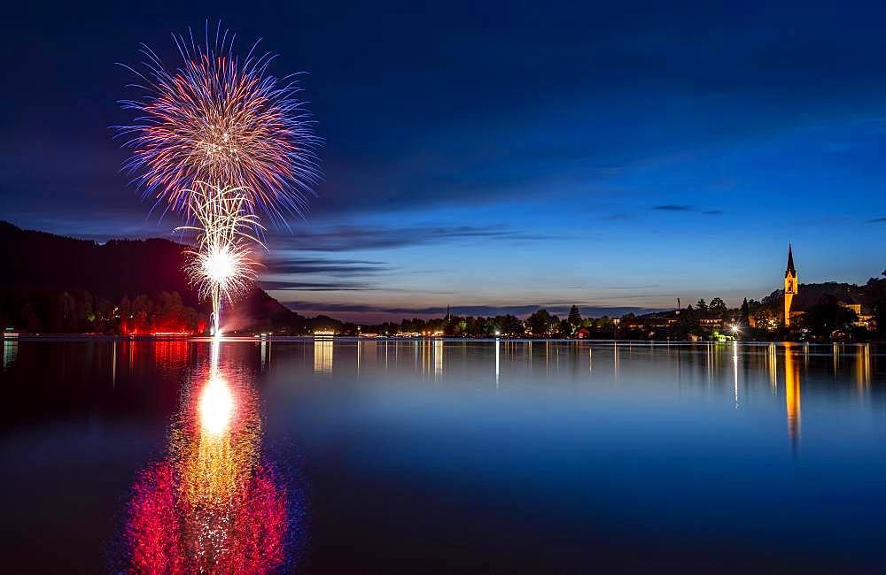 Fireworks, reflection in Lake Schliersee, St. Sixtus Parish Church, Schliersee, Upper Bavaria, Bavaria, Germany, Europe