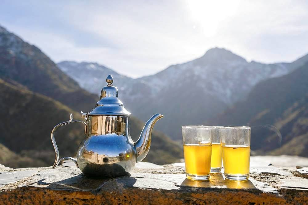 Moroccan mint tea and kettle in High Atlas mountains, Aroumd, Morocco, Africa