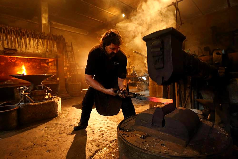 Blacksmith at the forge hammer, hammer mill Burghausen, Upper Bavaria, Bavaria, Germany, Europe - 832-387018