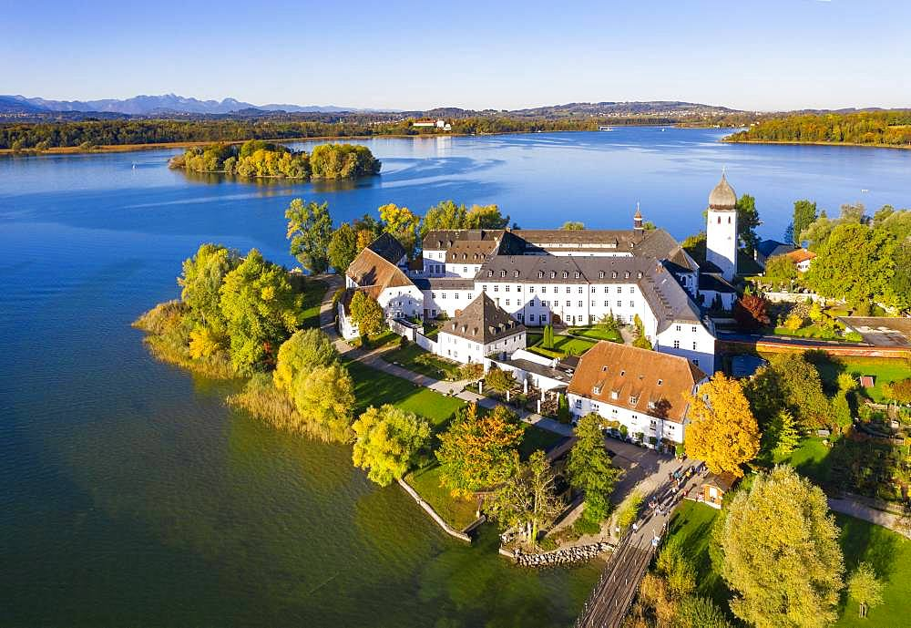 Benedictine monastery Frauenwoerth on Fraueninsel, Frauenchiemsee, behind Krautinsel and Herreninsel, Chiemsee, Alps, Chiemgau, aerial view, foothills of the Alps, Upper Bavaria, Bavaria, Germany, Europe - 832-387051