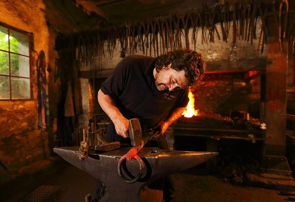 Blacksmith at the anvil, hammer mill Burghausen, Upper Bavaria, Bavaria, Germany, Europe - 832-387057