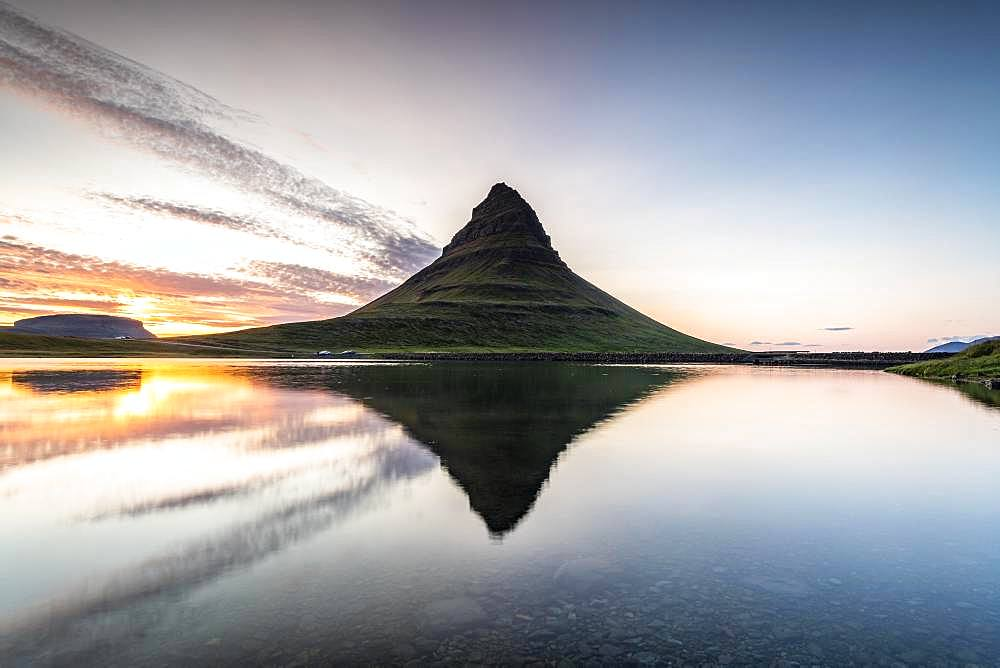 Mountain Kirkjufell reflected in the water, sunset, Grundarfjoerdur, Snaefellsnes Peninsula, Snaefellsnes, Vesturland, Iceland, Europe