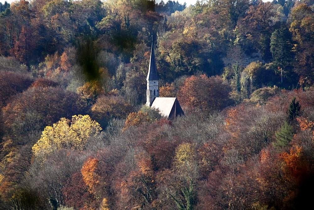 Church surrounded by trees in autumn, Heilig Kreuz, Burghausen, Upper Bavaria, Bavaria, Germany, Europe