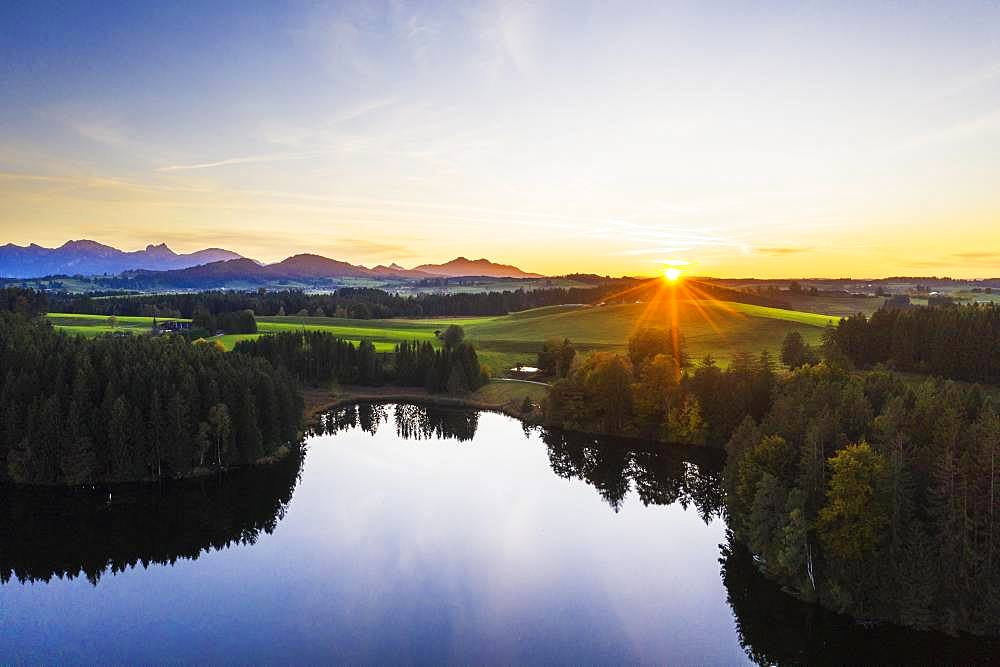 Sunset at the Schmutterweiher pond, near Rosshaupten, drone shot, Ostallgaeu, Allgaeu, Alpine foreland, Swabia, Bavaria, Germany, Europe