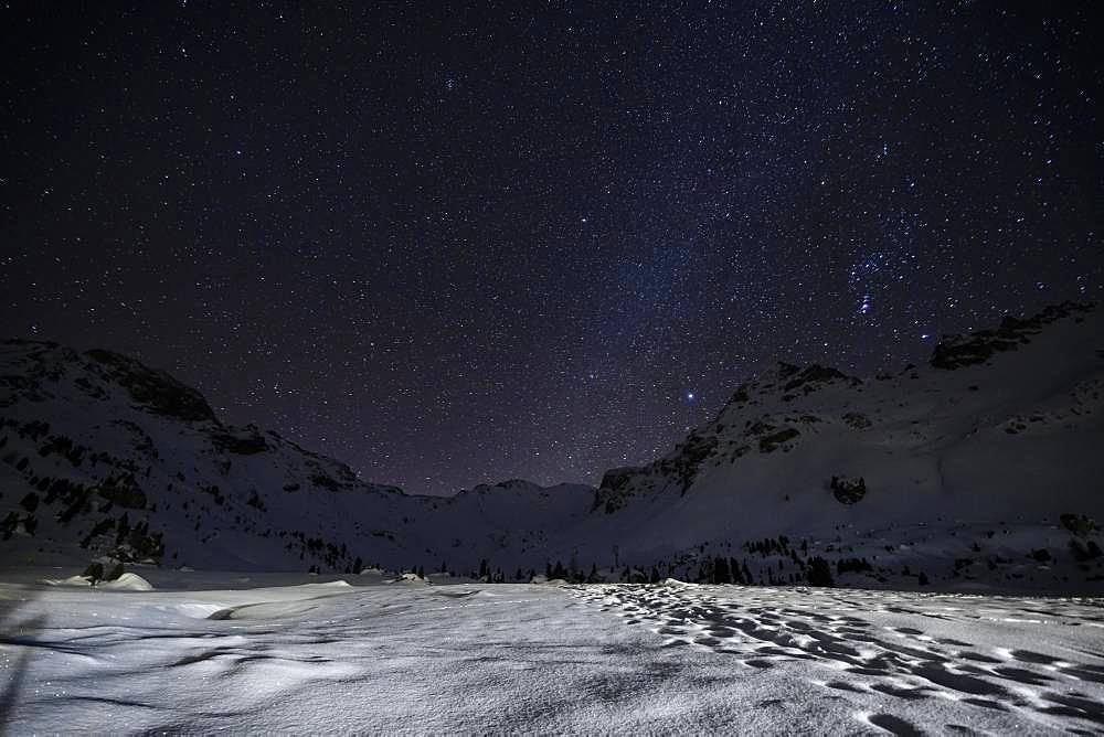 Starry sky with milky way in the mountains in winter, Wattentaler Lizum, Tuxer Alps, Tyrol, Austria, Europe