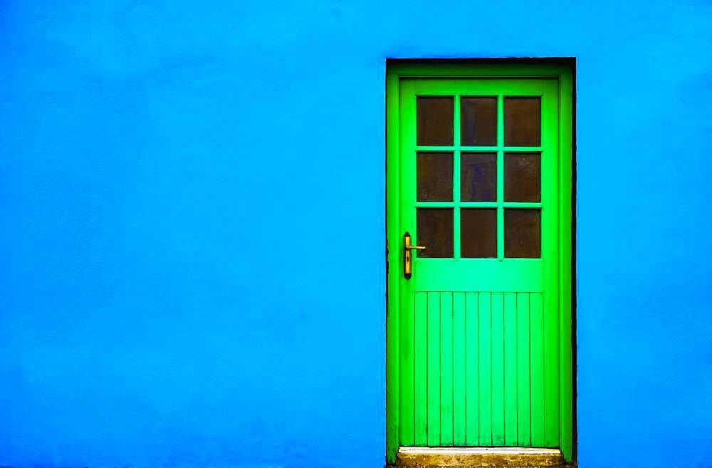Blue house facade with green front door, Burren, West Coast, County Clare, Republic of Ireland