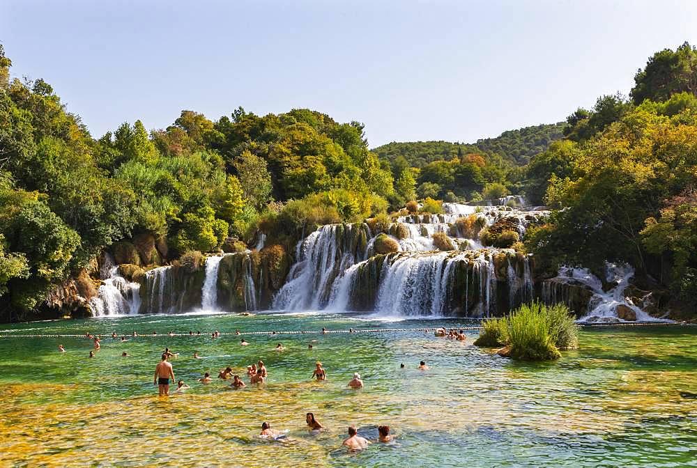 Tourists bathing at the Skradinski Buk waterfall, Krka National Park, Sibenik-Knees Region, Dalmatia, Croatia, Europe